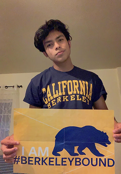 "Gerson holds a a poster that reads ""I AM #BERKELEYBOUND"""