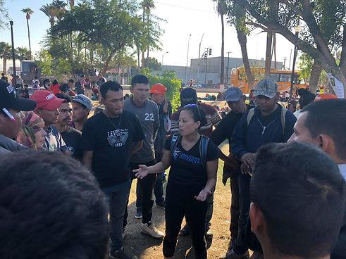Lisa Okamoto speaks with a group of people in Tijuana.