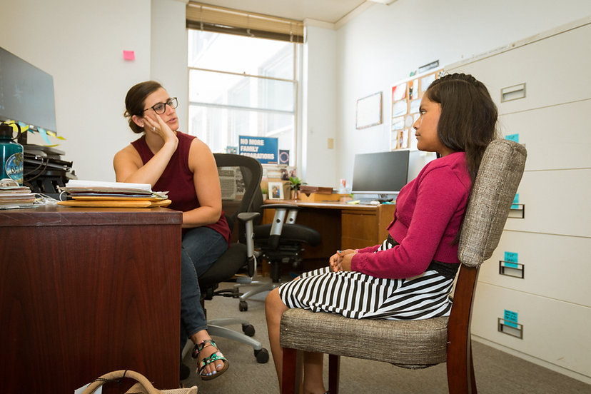 Neysa Nankervis, Staff Attorney works with a young client.