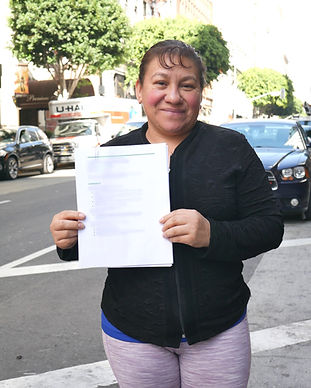 Our client, Maura proudly holds a resume we helped her write