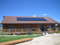 Photovoltaic (PV) Panels Mounted on Cabin Roof