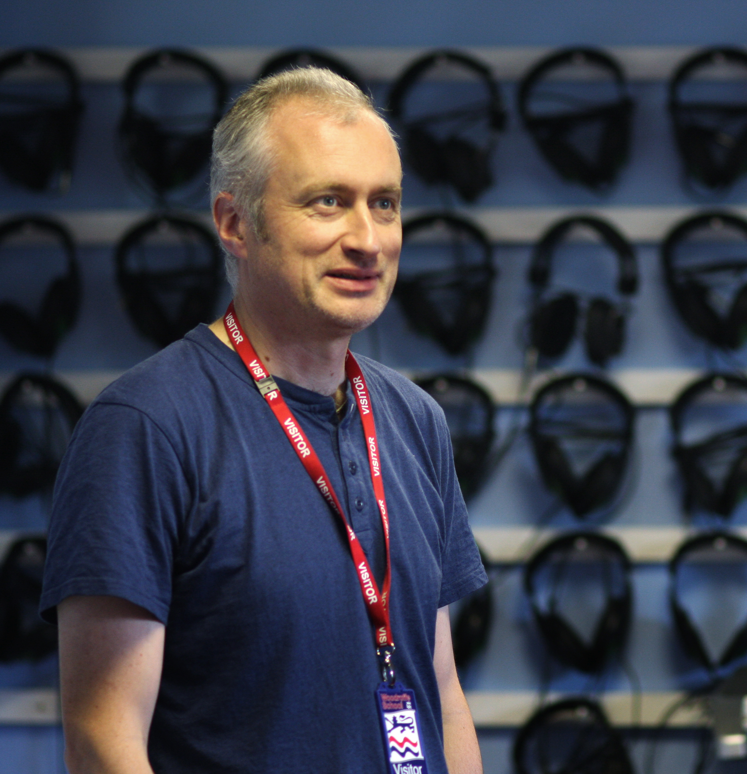 John surrounded by headphones