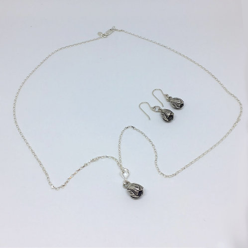 Sterling silver hand-sourced necklace and sterling silver matching earrings.