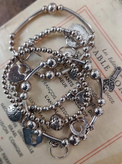 GAS - Lot de 4 bracelet argentés et pampilles