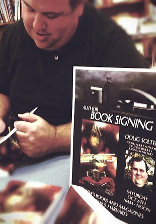 A very cool shot of Doug signing books (