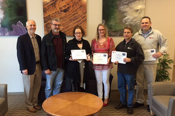The 6-member ICF Team was recently presented with a Barrios Silver BEAR awards. Pictured from left are: The 6-member ICF Team was recently presented with a Barrios Silver BEAR awards. Pictured from left are: Robert McAfoos, Barrios Technology President; Jessica Henderson; Ann Herring; Mark Zutek; and Richard Morphis. Not Pictured: Mary Kerber and Todd O'Neal.