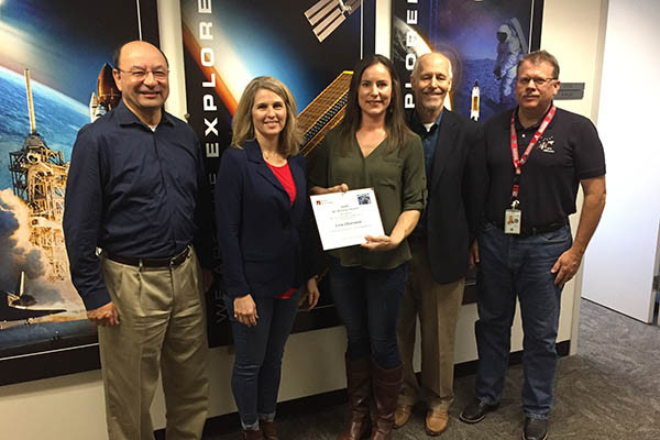 Erin Thornton was recently presented with a Barrios Silver BEAR award. Pictured from left are: Mark Polansky, MAPI Program Manager; Cheri Armstrong, MAPI Supervisor; Thornton; Robert McAfoos, Barrios Technology President; Bill Cleek, Program Planning and Control Manager, ISS.
