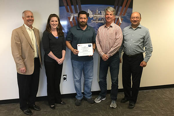 Erik Marsh was recently presented with a Barrios Silver BEAR award. Pictured from left are: Robert McAfoos, Barrios Technology President; Ashley Arciero, Safety and Mission Assurance Manager, MAPI; Marsh; Phil Mortillaro, (nominator) Safety Mission and Assurance, NASA; Mark Polansky, MAPI Program Manager.