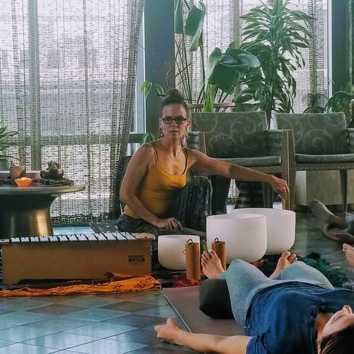 Artis Moon guiding a Yoga Nidra Sound Bath at the Appollo