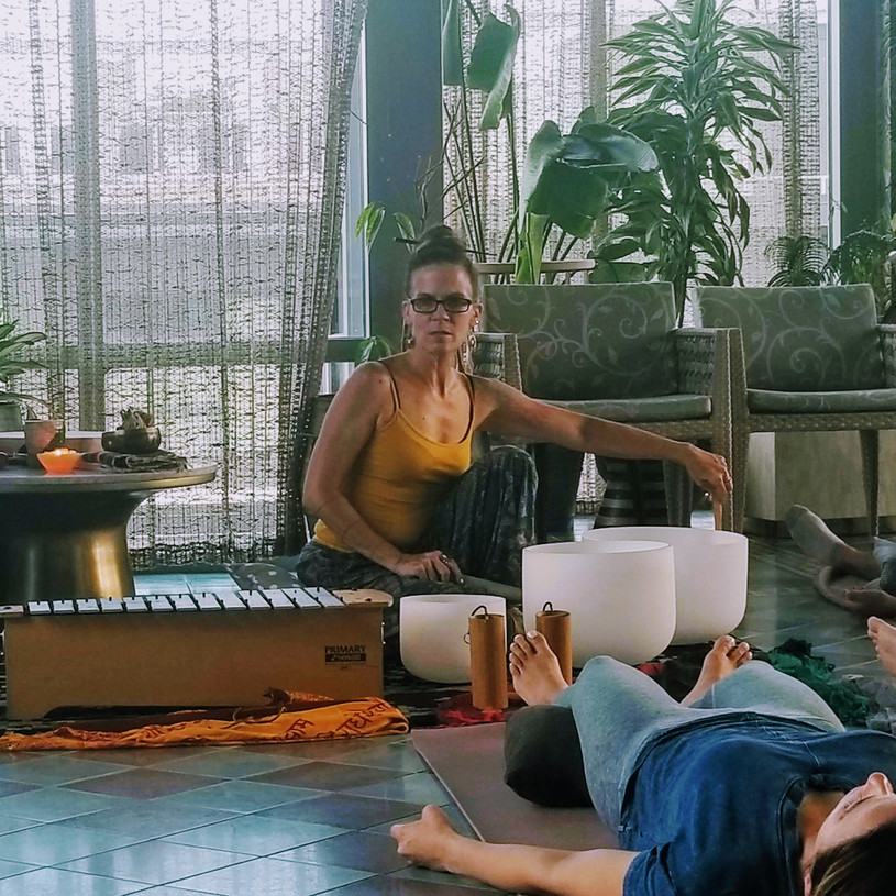 Artis Moon guiding a Yoga Nidra Sound Bath at the Appollo