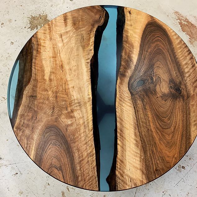 Round walnut epoxy river table