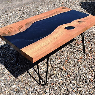 Black metallic epoxy river table