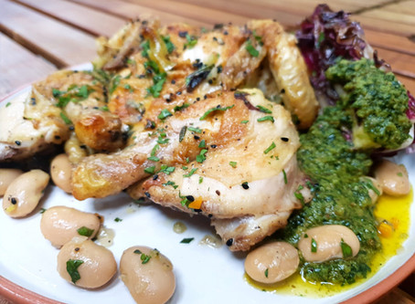 Roast Poussin with grilled radicchio, butter beans,toasted  hazelnut and sorrel pesto