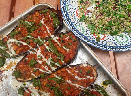 Baked stuffed aubergine with tomato and chickpeas