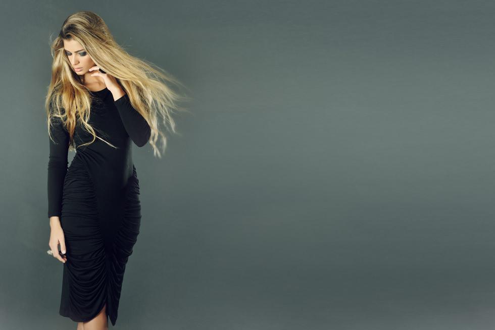 Shell Modeling a Black Dress