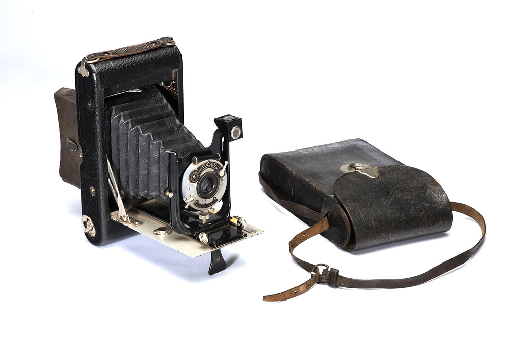 Camera and leather case. Gift of Mr Kevin Joseph Waldron, 1996. MAGNT Collection TH98/088