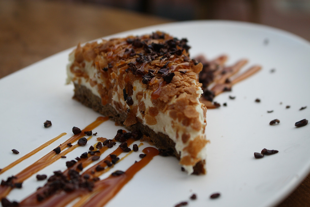 white chocolate mousse cake gingersnap crust, salted caramel, candied cocoa nibs