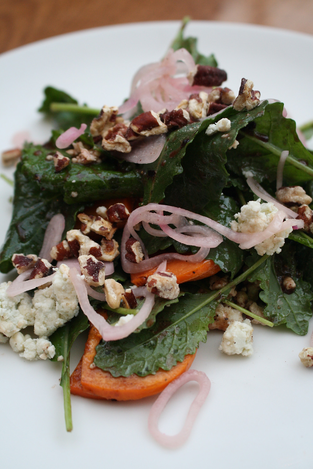 persimmon salad  baby kale, pickled shallots, blue cheese, pecans,  huckleberry vinaigrette