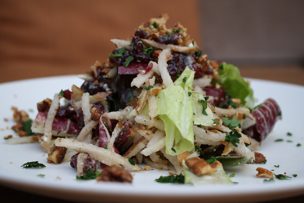 shaved pear salad chicories, dried cranberries, toasted walnuts, bacon-blue cheese vinaigrette