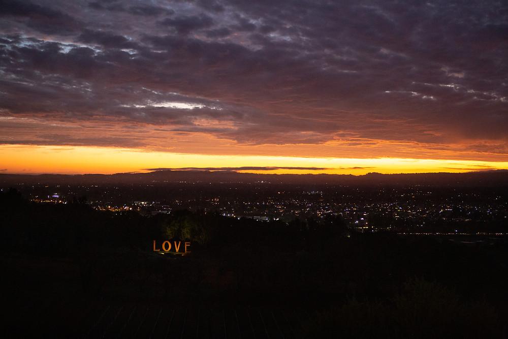 view of love sculpture and santa rosa at paradise ridge winery