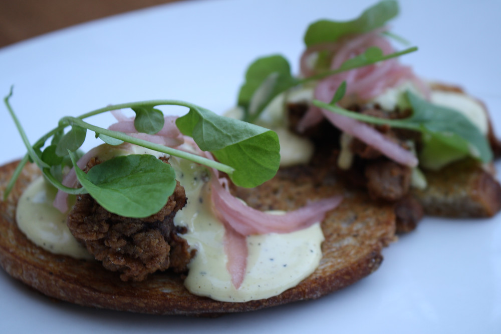 chicken liver tartine seared sourdough, black pepper hollandaise,  pickled red onions