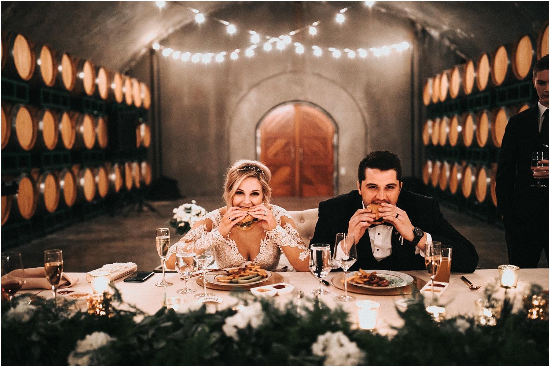 bride & groom enjoying hamburgers