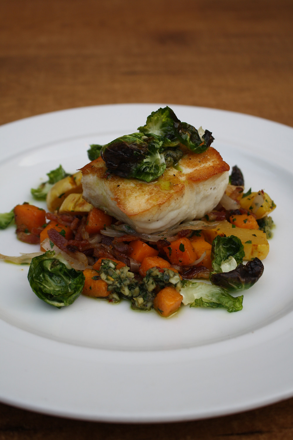 local halibut fall squash hash, house bacon, brussels sprout leaves, salsa verde