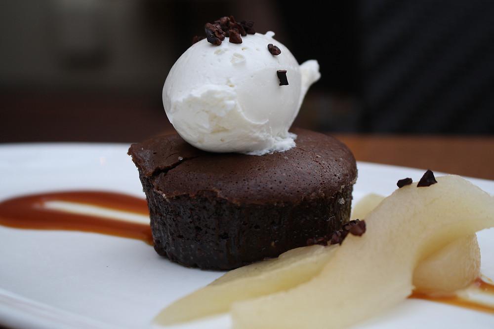 chocolate-hazelnut cake cinnamon poached pears, vanilla chantilly