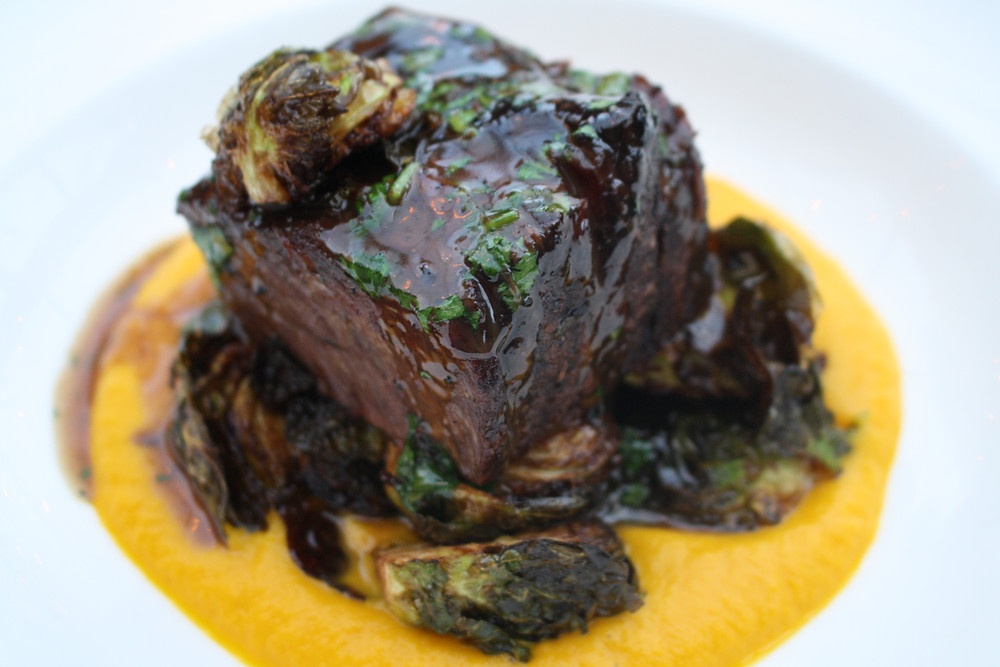 braised short ribs butternut squash purée, crispy brussels, braising reduction