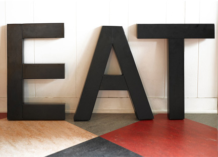Eat sign in black letters