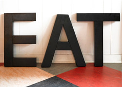 Eat sign in black letters