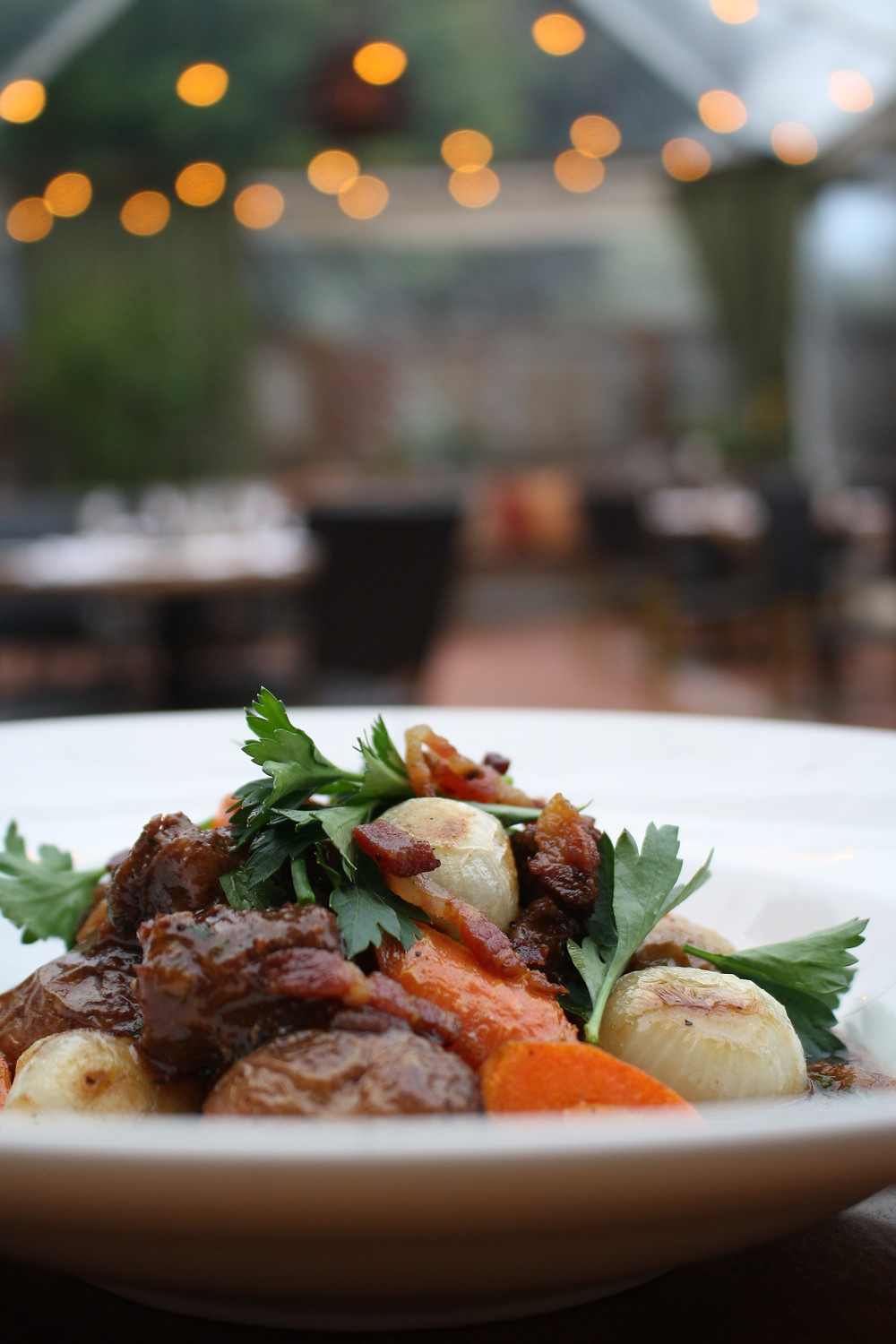 beef bourguignon house bacon, marble potatoes, pearl onions,  picked herbs