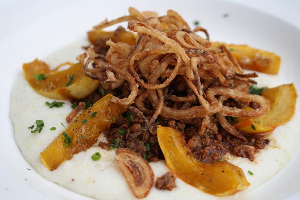 wild boar ragoût roasted delicata squash, creamy polenta,  crispy shallots