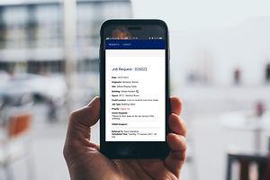 Holding Phone Web App.jpg