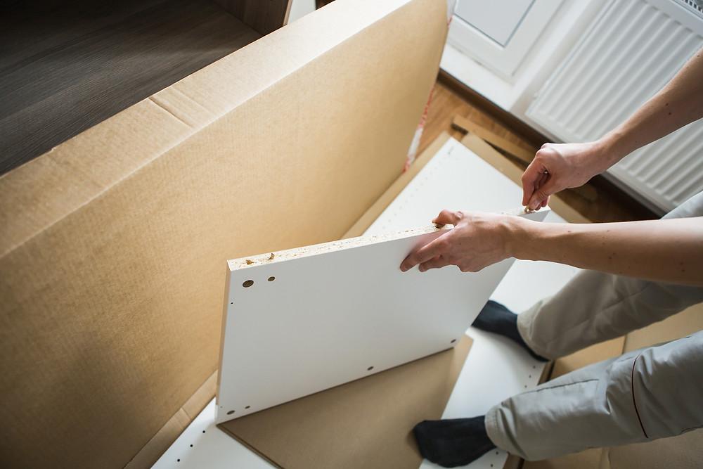 Man Assembling Furniture