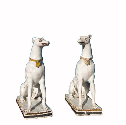 A pair of German late 17th century ceramic Greyhounds