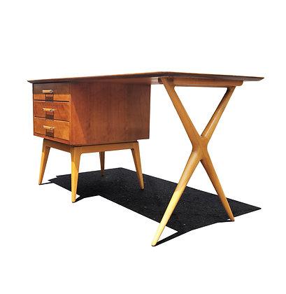 A mid-century modern desk by Renzo Rutili for Johnson furniture