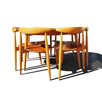 A Danish mid-century modern Hans Wegner Heart dining set.