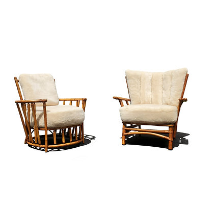 A pair of mid-century modern bamboo lounge chairs