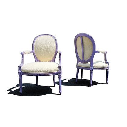 A pair of French Louis XVI 19th century cabriolet lounge chairs