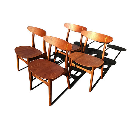A Set of 4 Hans Wegner CH-30 dining chairs produced by Carl Hansen & Son.