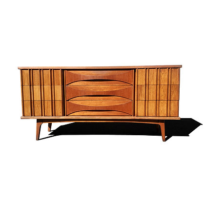 A mid-century modern curved front dresser - credenza by United furniture