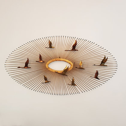 A Mid-century Curtis Jere Wildgeese and sun Wall sculpture