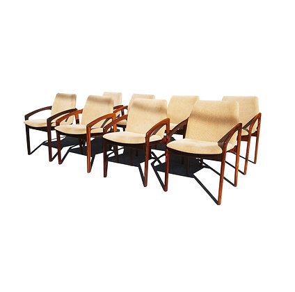A set of 8 Danish modern rosewood Henning Kjaernulf  dining chairs