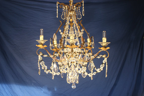 A French 1940's gilt Iron crystal and pearls chandelier