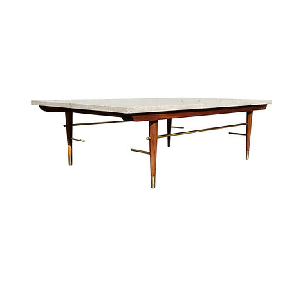 A mid-century travertine, brass and walnut coffee table