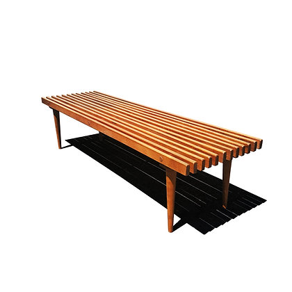 A large mid-century modern slat bench
