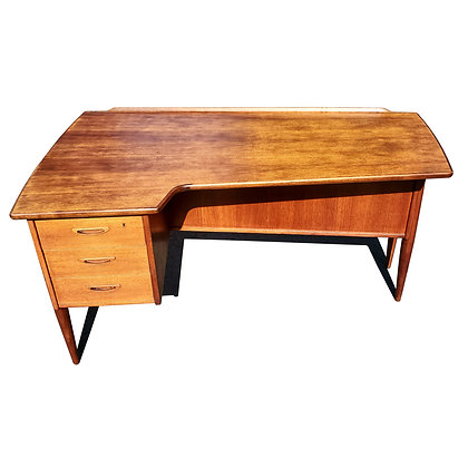 A mid-century modern teak wood Boomerang desk by GORAN STRAND FOR LELÅNGS