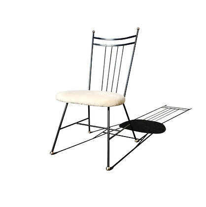 A mid-century modern iron / wire high back single chair
