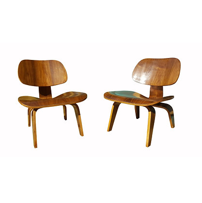 A pair of vintage mid century modern Charles Eames LCW plywood lounge chairs